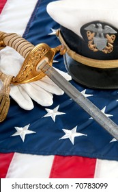 military sword and gloves on US flag