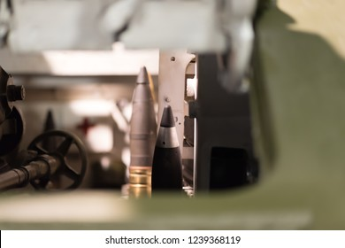 Military Tank Interior View. Cannon ammunition inside tank in ammunition stowage rack
