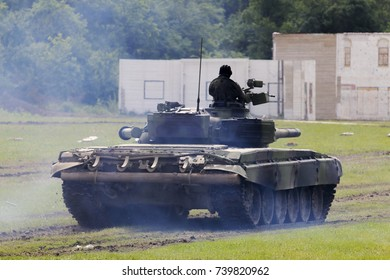 Military tank on a dirt ground terrain aiming and shooting. Russ