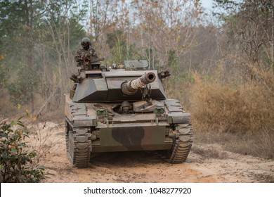 Military  tank ready to attack and moving over a deserted battle field terrain ,battle operation