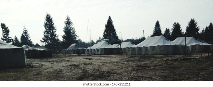 military tent camp located in the forest