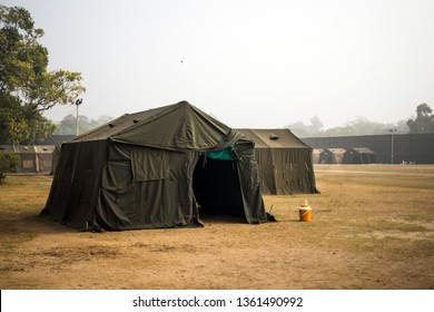 Military tent in the field. big tent city. field camp in nature. military base with temporary barracks. military exercises of the soldiers. large military tent. Army camp. reconstruction warfare