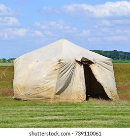 Military tent on the meadow in summer time