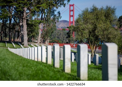 Military Tombstones at cemetery with Golden Gate Bridge on the background