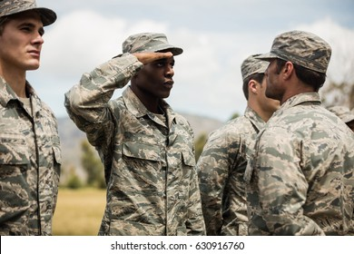 Military trainer giving training to military soldier at boot camp