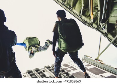 Military transport aircraft c-130, military drills, the paratroopers, from the rear of the aircraft, tactical flight training at sea (Photo Old Vintage).