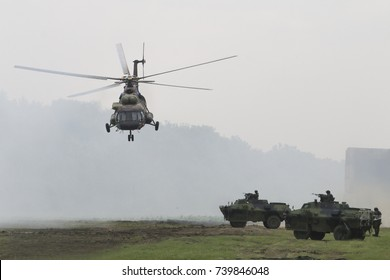 Military transport helicopter Mi 17 and armored vehicle attackin