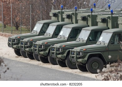Military vehicles standing in line