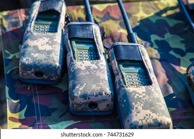 Military walkie talkie radio in camouflage cover. walkie-talkie communication radio.