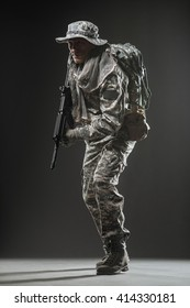 Military, war, conflict, soldiers - Special forces soldier man hold Machine gun on a  dark background.