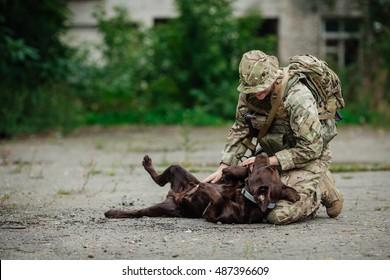 Military Woman Hugs Dog