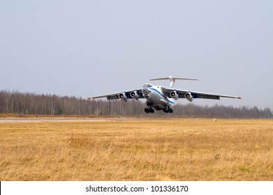 The military-transport plane flying up from airdrome