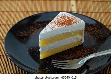 Milk cake on black plate
