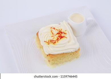 Milk Cake Saffron on white plate