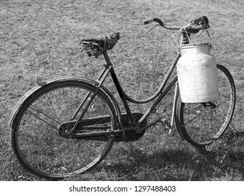 milk can aluminum used once a long time ago by the milkman to deliver the beverage to the dairy by an old bike
