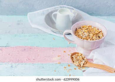 Milk and cereals in bowl over wooden background