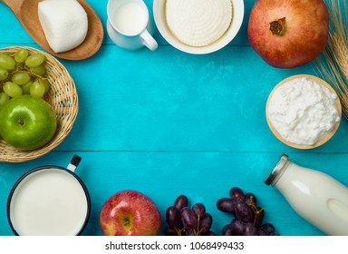Milk and cheese, dairy products, fruits on wooden background. Jewish holiday Shavuot concept. Top view