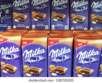 milk chocolate with peanut and crispy caramel of Milka trade mark, on a shelf in a supermarket in Kiev, Ukraine, 15 January 2019.