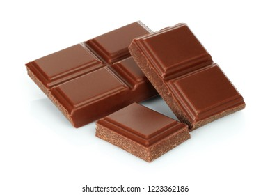 Milk chocolate pieces isolated on white background.