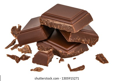 Milk chocolate pieces isolated on white background from top view.