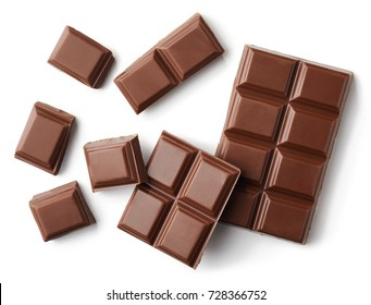 Milk chocolate pieces isolated on white background from top view