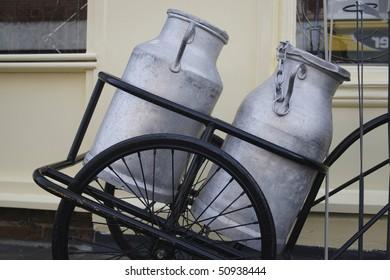 Milk churns in cart