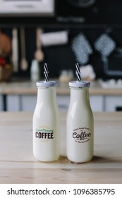 milk cocktail in a glass bottle. coffee milkshake. morning breakfast