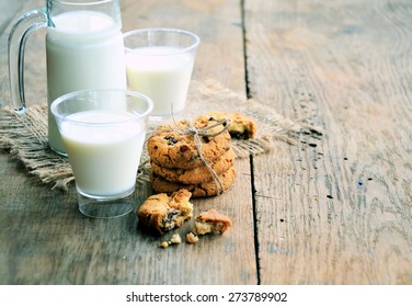 milk and cookies on the wooden table