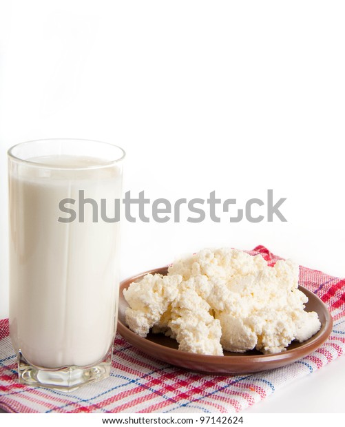 Milk and cottage cheese on the red napkin, a healthy breakfast