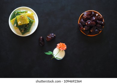 Milk and dates on the black table. Sweet food for Ramadan