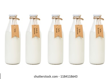 Milk in glass bottles with labels - (labels: milk, almonds, soy, without lactose, oat)