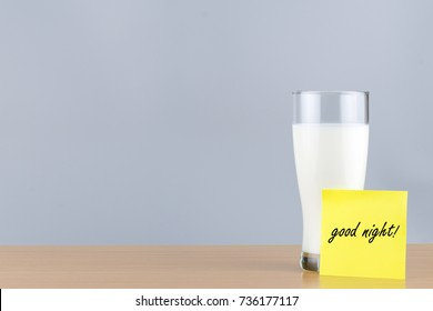 """Milk in a glass and """" Good Night """" on Note Paper"""