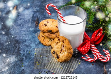 Milk and homemade chocolate chips and cranberrry cookies for Santa. Traditional snack for Santa Claus. Christmas greeting card. Copy space