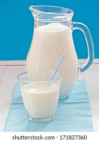 Milk in a jug before blue background
