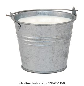 Milk in a miniature metal bucket, isolated on a white background