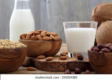 milk of nuts on rustic wooden table background
