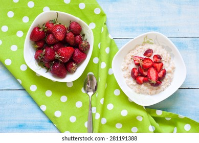 Milk oatmeal porridge with strawberries. Healthy Breakfast