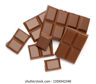 Milk organic chocolate pieces isolated on white background