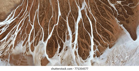 milk overflowing from a nipple, abstract photography of the deserts of Africa from the air, bird's eye view, abstract expressionism, contemporary art, optical illusions,