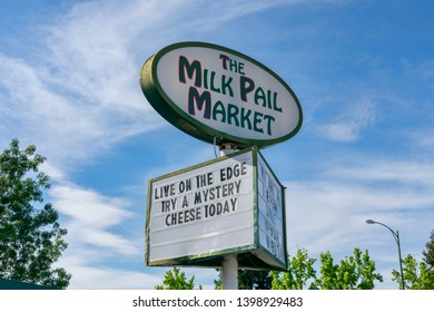 Milk Pail Market pylon advertising sign of European style mom-and-pop open air market - Mountain View, California - May 13, 2019