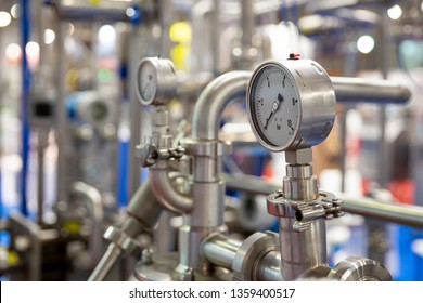 Milk pasteurization system is shown at a food and drink exhibition. Heat Treatments. Pasteurization is a process that kills microbes in food and drink. Pressure measuring instrument.