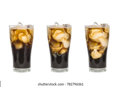 milk pour in glass of ice coffee in white background, isolated with clipping path