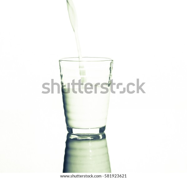 Milk pouring into the glass