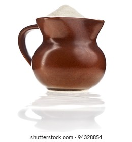 milk powder drink in clay pitcher Isolated on white background