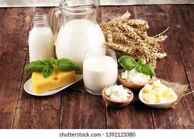 milk products. tasty healthy dairy products on a table and milk jar, glass bottle and cheese