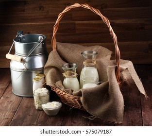 milk products - tasty healthy dairy products on a table on: sour cream in a white bowl, cottage cheese bowl, cream in a a bank and milk jar, glass bottle and in a glass