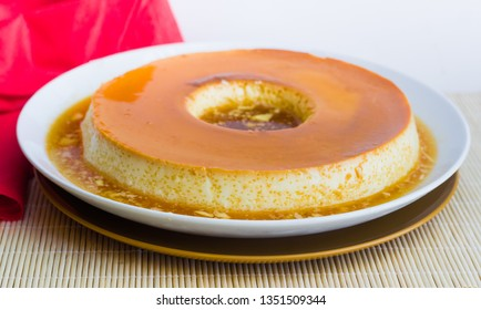 Milk Pudding or Pudim de leite. Brazilian dessert homemade caramel custard pudding and condensed milk. Tradition brazilian flan. Blurred background.
