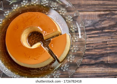 Milk Pudding or Pudim de leite. Brazilian dessert homemade caramel custard pudding. Traditional brazilian flan on wooden background