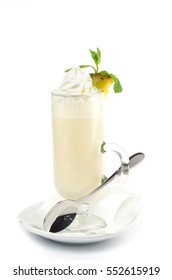 Milk Punch decorated with pineapple, Served on white background