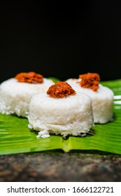 The milk rice on a banana leaf. Milk rice is a traditional Sri Lankan food made from rice and coconut milk which is used to be a main food on any cultural ceremony or occasion